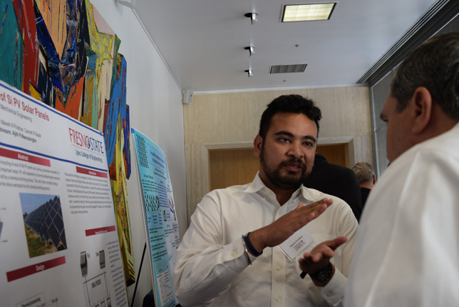 Fresno State University student Nikhesh Pradhan explains his poster, which also happened to be a contest winner.